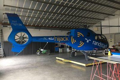 Helikopter wrappen voor reclamevlucht